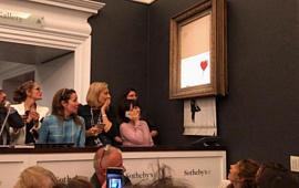 Картина Бэнкси, проданная за $1.4 млн, самоуничтожилась сразу после окончания аукциона